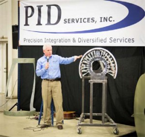Scott Slusher, president and CEO of Precision Integration & Diversified Services Inc., talks about the parts produced by the Lufkin business, which employs more than 60 people at its facility on Southpark Drive.